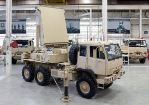 A vehicle in the shop, getting prepared for a coating of CARC paint.